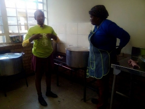 Young reporters helping nutrition staff to prepare a meal for the school